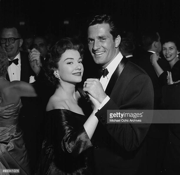 Actress Anne Baxter dances with actor Hugh O'Brian during the Screen Actors Guild party in Los Angeles California