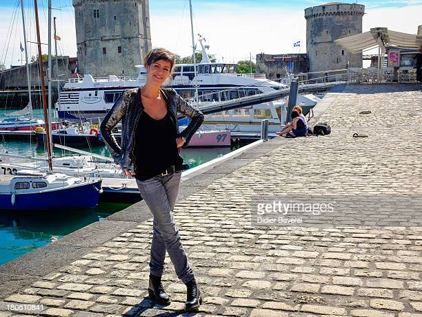 Actress Anne Caillon poses during the photocall of 'Dos Au Mur' at 15th Festival of TV Fiction on September 13 2013 in La Rochelle France