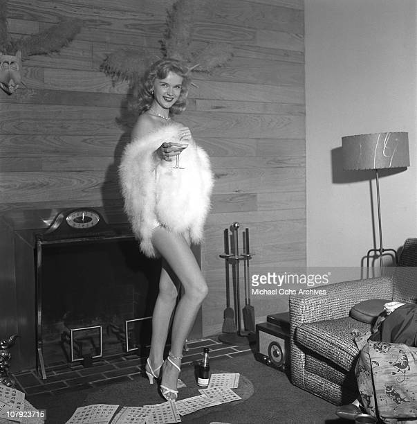Actress Anne Francis toasts the New Year on August 28 1953 in Los Angeles California