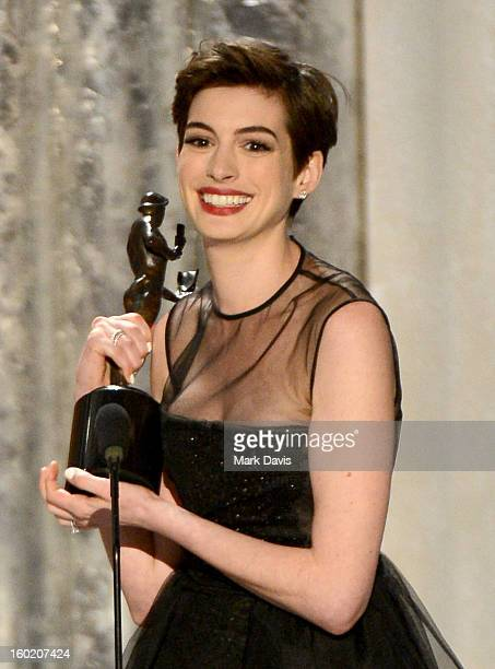Actress Anne Hathaway accepts the award for Outstanding Performance by a Female Actor in a Supporting Role for 'Les Miserables' onstage during the...