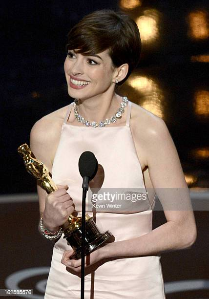 Actress Anne Hathaway accepts the Best Supporting Actress award for Les Miserables onstage during the Oscars held at the Dolby Theatre on February 24...