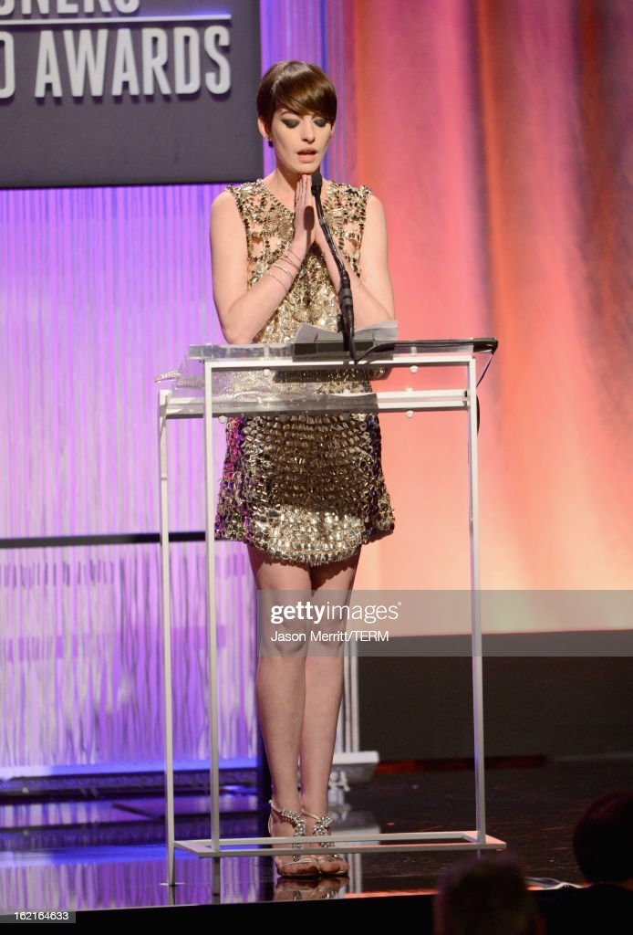 Actress Anne Hathaway accepts the Lacoste Spotlight Award onstage during the 15th Annual Costume Designers Guild Awards with presenting sponsor Lacoste at The Beverly Hilton Hotel on February 19, 2013 in Beverly Hills, California.