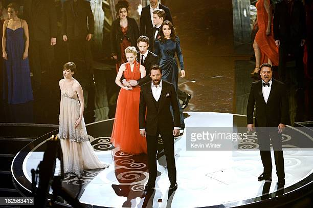 Actress Anne Hathaway actor Hugh Jackman and actor Russell Crowe and members of the cast of Les Miserables perform onstage during the Oscars held at...
