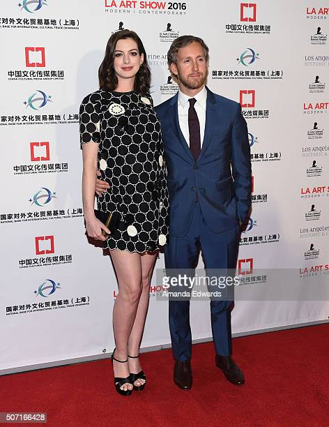 Actress Anne Hathaway and actor Adam Shulman arrive at the LA Art Show and Los Angeles Fine Art Show's 2016 Opening Night Premiere Party benefiting...