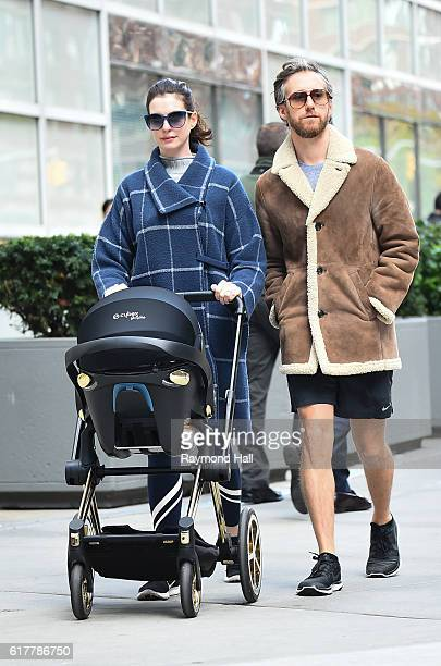 Actress Anne Hathaway and Adam Shulman are seen walking with son Jonathan in Midtown on October 24 2016 in New York City