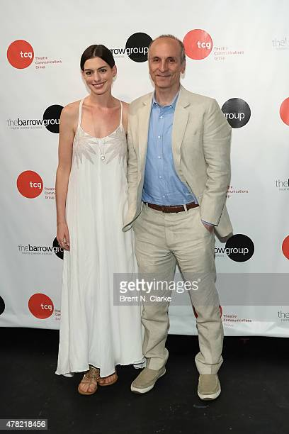 Actress Anne Hathaway and author Seth Barrish pose for photographs during An Actor's Companion book release held at The Barrow Group on June 23 2015...