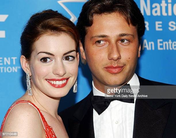 Actress Anne Hathaway and boyfriend Raffaello Follieri are on hand for a bash aboard the Queen Mary 2 at Pier 92 benefiting the Entertainment...