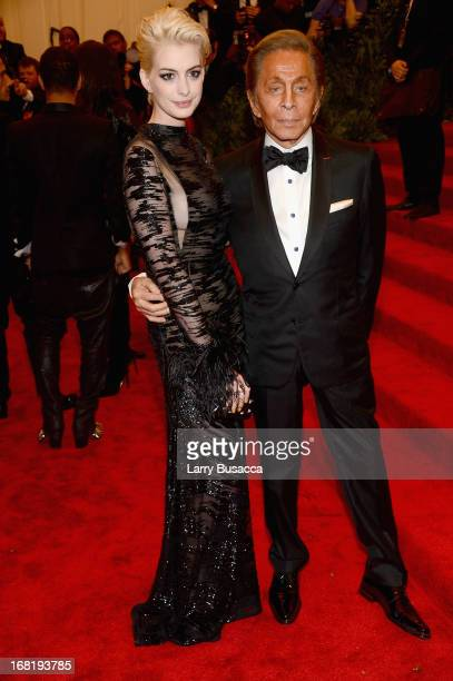Actress Anne Hathaway and designer Valentino Garavani attend the Costume Institute Gala for the 'PUNK Chaos to Couture' exhibition at the...