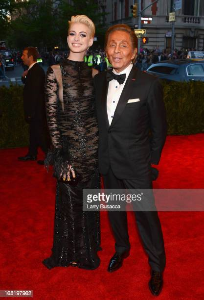 Actress Anne Hathaway and designer Valentino Garavani attends the Costume Institute Gala for the 'PUNK Chaos to Couture' exhibition at the...