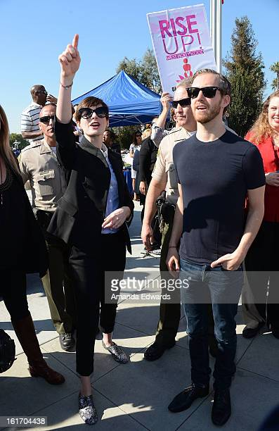 Actress Anne Hathaway and her husband Adam Shulman help kick-off One Billion Rising on February 14, 2013 in West Hollywood, California.