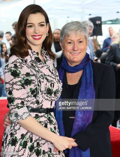 US actress Anne Hathaway and her mom Kate McCauley Hathaway stand on Hathaway's newly unveilled Star on the Hollywood Walk Of Fame in front of the...