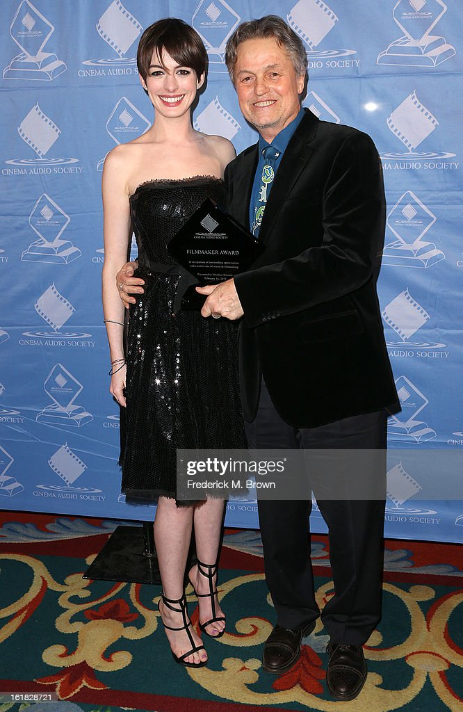 Actress Anne Hathaway (L) and honoree Jonathan Demme attend the 49th Annual Cinema Audio Society Awards 'CAS' at the Millennium Biltmore Hotel on February 16, 2013 in Los Angeles, California.