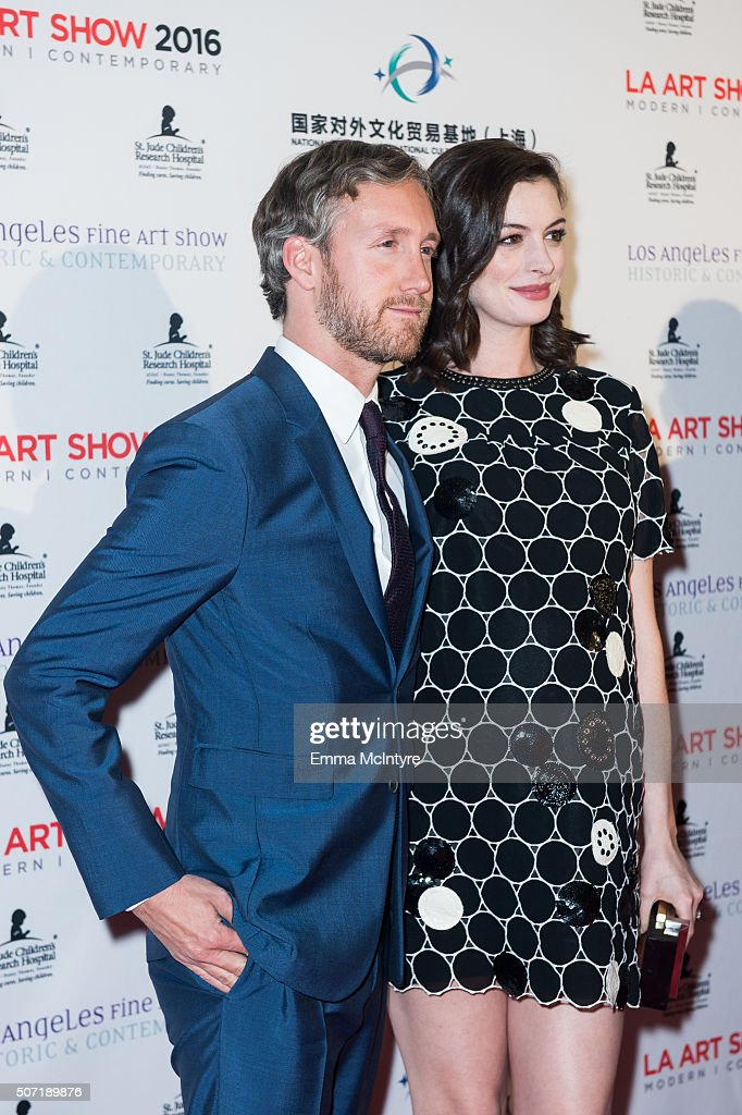 Actress Anne Hathaway and husband Adam Shulman arrive at LA Art Show And Los Angeles Fine Art Show's 2016 Opening Night Premiere Party Benefiting St. Jude Children's Research Hospitalat Los Angeles Convention Center on January 27, 2016 in Los Angeles, California.