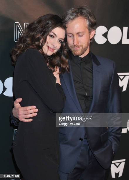"""Actress Anne Hathaway and husband Adam Shulman arrive at the premiere of Neon's """"Colossal"""" at the Vista Theatre on April 4, 2017 in Los Angeles,..."""