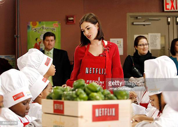 Actress Anne Hathaway appears at the Kids Cafe in Harlem for the Netflix Holiday Gift Program to raise money for Feeding America on December 15 2008...
