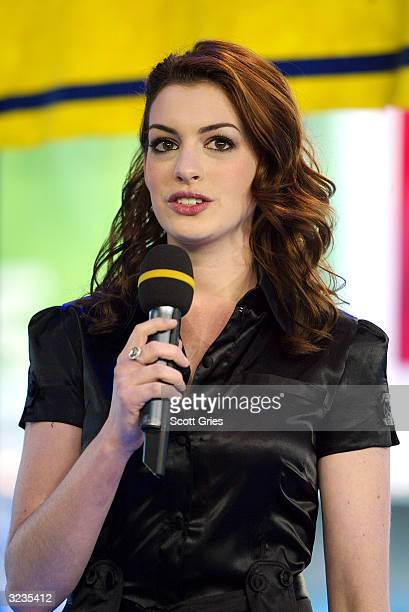 Actress Anne Hathaway appears on stage during MTV's High School Week on Total Request Live at the MTV Times Square Studios April 6 2004 in New York...