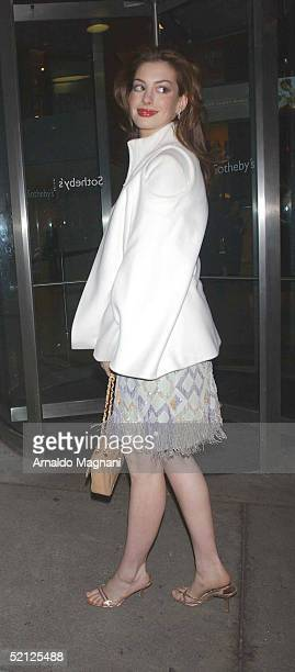 Actress Anne Hathaway arrives at Sotheby's for an AmFar and ACRIA sponsored benefit to honor Herb Ritts February 2 2005 in New York City