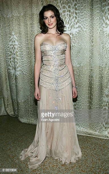 Actress Anne Hathaway attends a preview gala dinner for the Metropolitan Museum's 'Wild Fashion Untamed' exhibition hosted by fashion designer Robert...