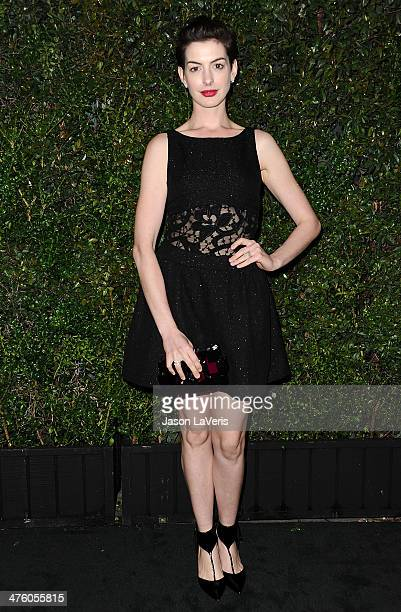 Actress Anne Hathaway attends the Chanel and Charles Finch preOscar dinner at Madeo Restaurant on March 1 2014 in Los Angeles California
