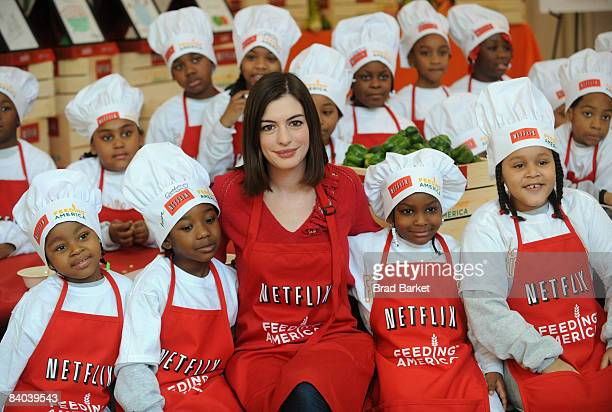 Actress Anne Hathaway attends the Feeding America organization along with Netflix to combat hunger at the Renaissance Cafe December 15 2008 in New...