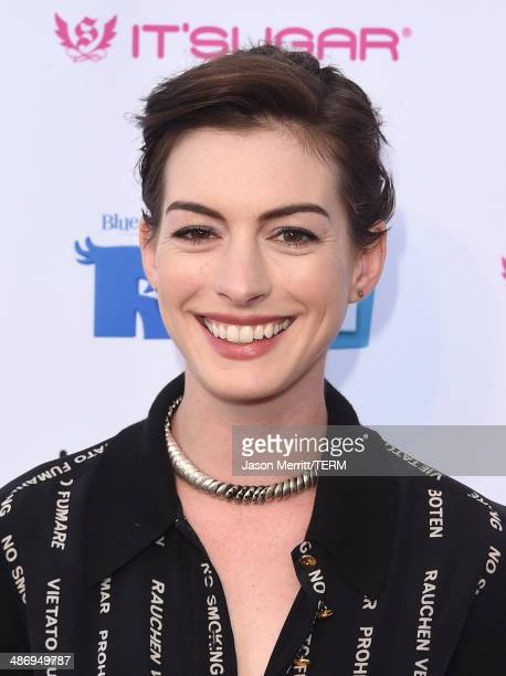 Actress Anne Hathaway attends the Lollipop Theater Network's Night Under The Stars Screening Of Twentieth Century Fox's 'Rio 2' Hosted by Anne...