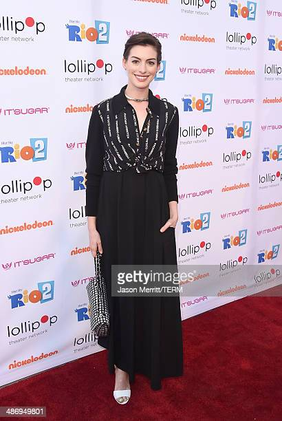 """Actress Anne Hathaway attends the Lollipop Theater Network's Night Under The Stars Screening Of Twentieth Century Fox's """"Rio 2"""" Hosted by Anne..."""