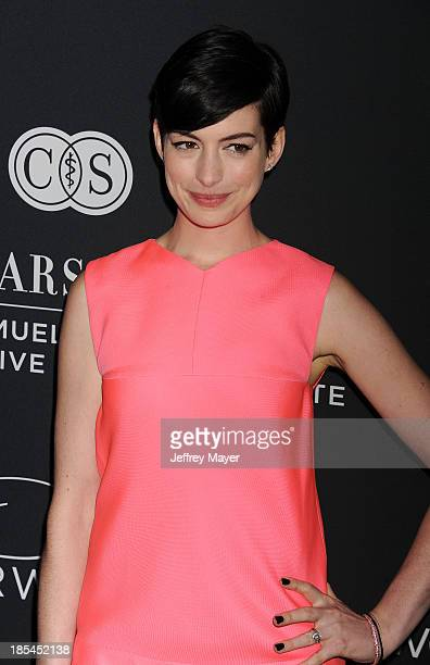 Actress Anne Hathaway attends The Pink Party 2013 at Barker Hangar on October 19 2013 in Santa Monica California