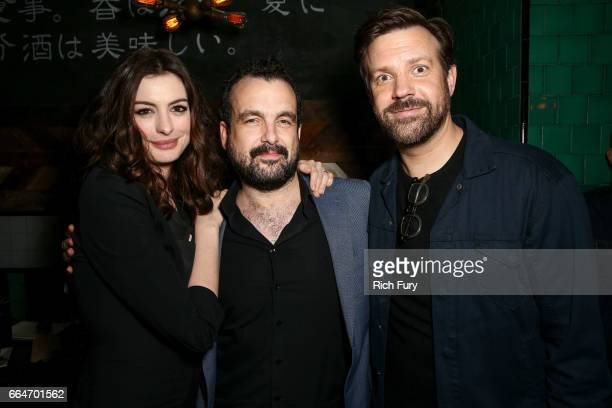Actress Anne Hathaway director Nacho Vigalondo and actor Jason Sudeikis attend the after party for the premiere of Neon's 'Colossal' at Umami Burger...
