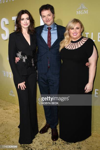 US actress Anne Hathaway English director and actor Chris Addison and Australian actress Rebel Wilson arrive to the premiere of The Hustle at the...