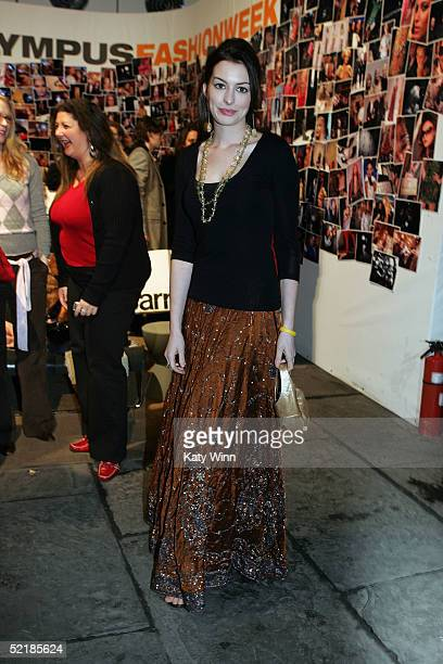 Actress Anne Hathaway poses for photos in the lobby of the main tent during Olympus Fashion Week Fall 2005 at Bryant Park February 11 2005 in New...