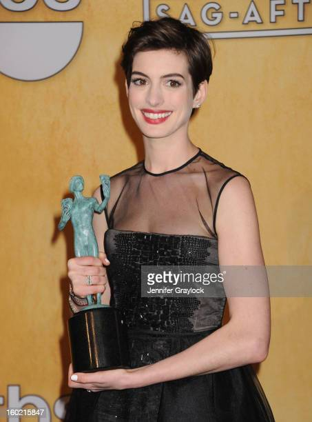 Actress Anne Hathaway poses in the press room at the 19th Annual Screen Actors Guild Awards at The Shrine Auditorium on January 27 2013 in Los...