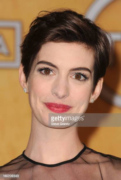 Actress Anne Hathaway poses in the press room during the 19th Annual Screen Actors Guild Awards held at The Shrine Auditorium on January 27 2013 in...