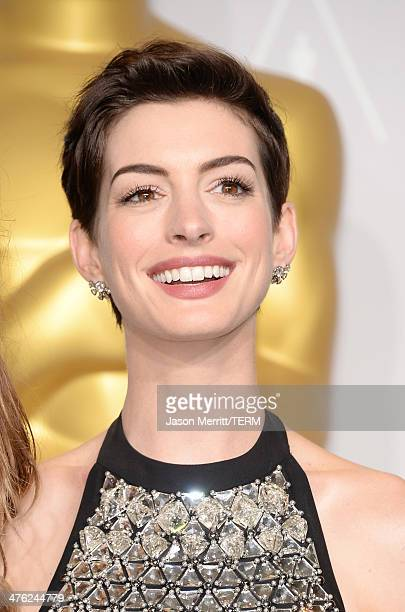 Actress Anne Hathaway poses in the press room during the Oscars at Loews Hollywood Hotel on March 2 2014 in Hollywood California