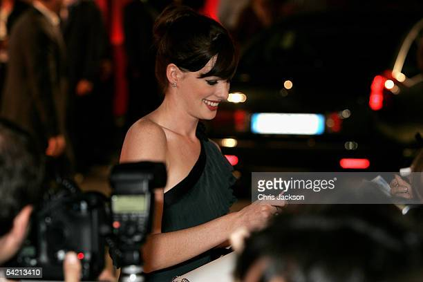Actress Anne Hathaway signs autographs as she arrives for the premiere of the incompetition film 'Brokeback Mountain' at the Palazzo del Cinema as...