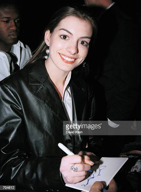 Actress Anne Hathaway signs autographs during ET The ExtraTerrestrial premiere after party at The Shrine Auditorium March 16 2002 in Los Angeles CA