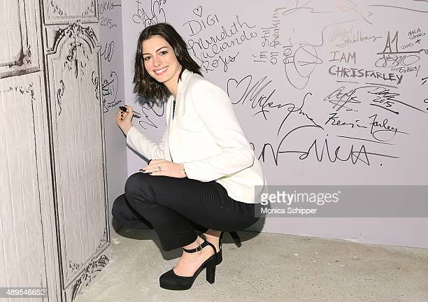 Actress Anne Hathaway signs the wall at AOL Studios when she attends AOL Build Presents 'The Intern' at AOL Studios In New York on September 22 2015...