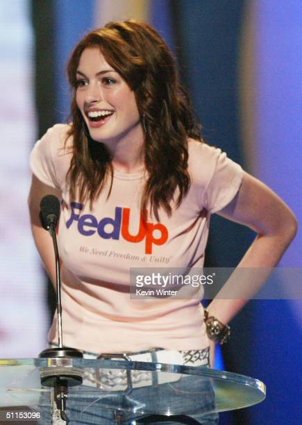 Actress Anne Hathaway speaks on stage at The 2004 Teen Choice Awards held on August 8 2004 at Universal Amphitheater in Universal City California