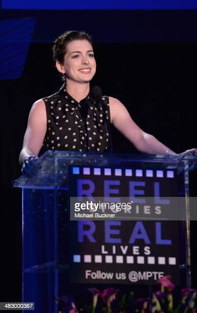 Actress Anne Hathaway speaks onstage during the 3rd Annual Reel Stories Real Lives Benefiting The Motion Picture Television Fund at Milk Studios on...