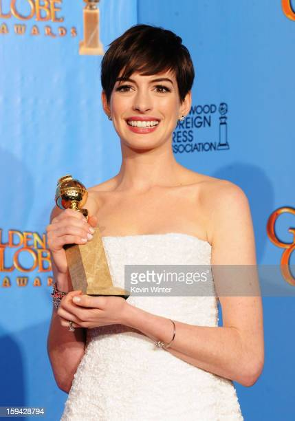 Actress Anne Hathaway winner of Best Supporting Actor in a Motion Picture for Les Miserables poses in the press room during the 70th Annual Golden...