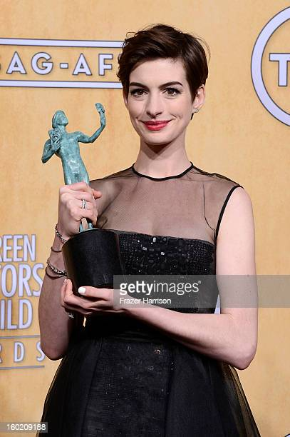 Actress Anne Hathaway winner of Outstanding Performance by a Female Actor in a Supporting Role for Les Miserables poses in the press room during the...