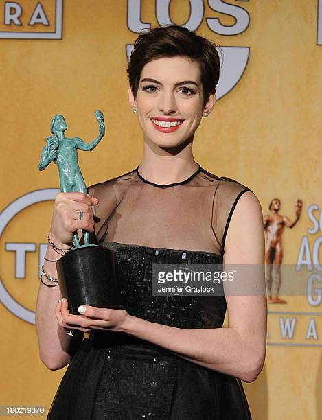 Actress Anne Hathaway winner of Outstanding Performance by a Female Actor in a Supporting Role for 'Les Miserables' poses in the press room during...