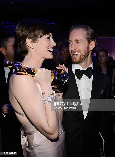 Actress Anne Hathaway winner of the Best Supporting Actress and husband Adam Shulman attend the Oscars Governors Ball at Hollywood Highland Center on...