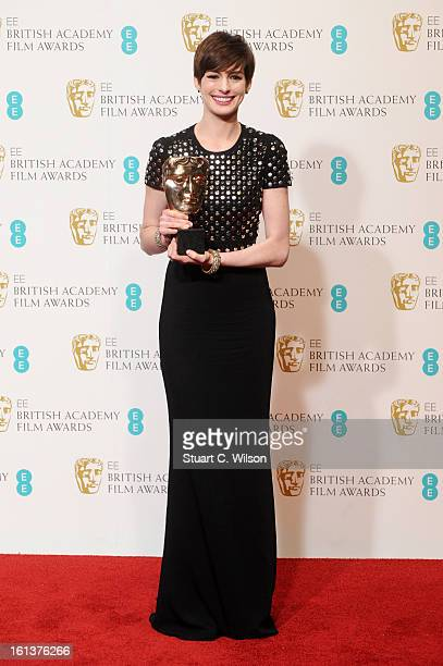 Actress Anne Hathaway winner of the Supporting Actress award poses in the press room at the EE British Academy Film Awards at The Royal Opera House...