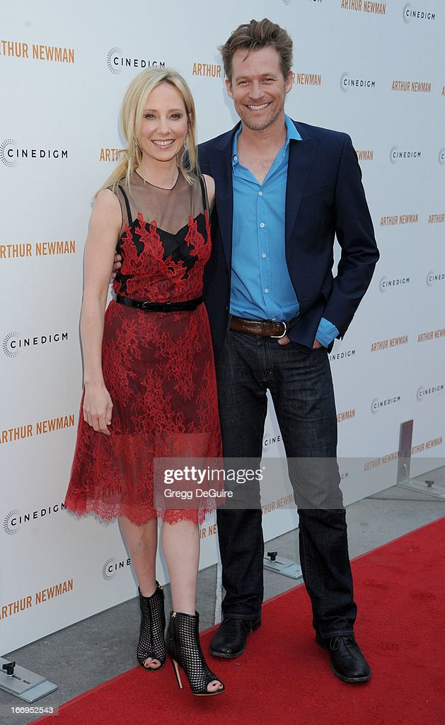 Actress Anne Heche and James Tupper arrive at the Los Angeles premiere of 'Arthur Newman' at ArcLight Hollywood on April 18, 2013 in Hollywood, California.