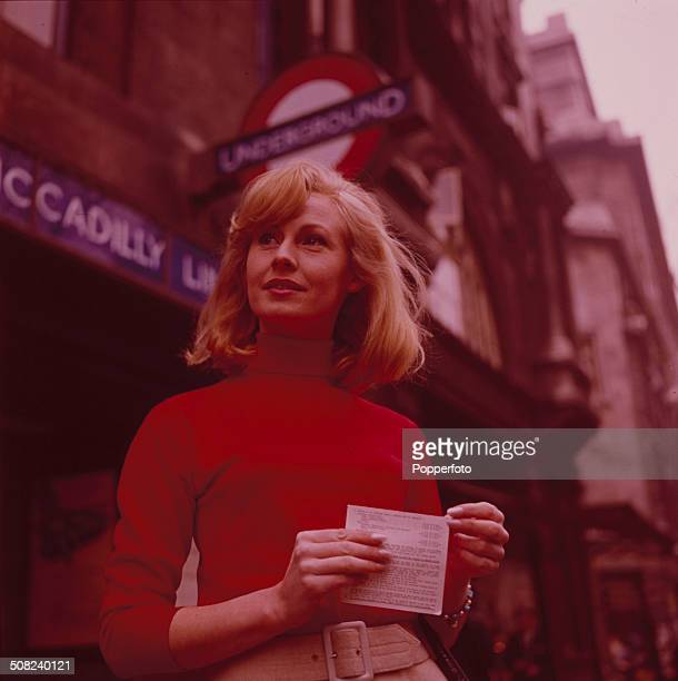 Actress Anne Lawson in front of an Underground station in London in 1965
