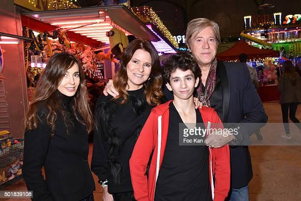 Actress Anne Parillaud designer Lolita Lempicka her husband Josh Lempicka and Theo Allan attend the 'Jours de Fete au Grand Palais' Fete foraine...