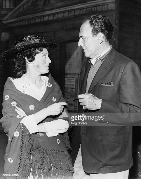 Actress Anne Rogers in costume as 'Eliza Doolittle' talking to director Moss Hart during rehearsals of the musical 'My Fair Lady' prior the opening...