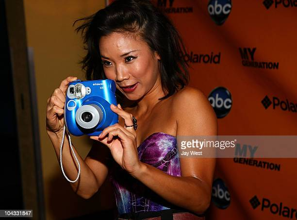 Actress Anne Son uses the new Polaroid 300 on the red carpet for the premeir of the new television series 'My Generation' at Alamo Drafthouse on...