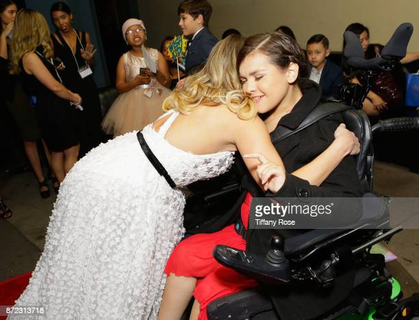 Actress Anne Winters with Wish Kids at the 2017 Make a Wish Gala on November 9 2017 in Los Angeles California