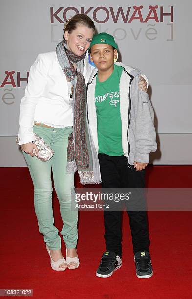 Actress AnneSophie Briest and her son Jahmar arrive for the ''Kokowaeaeh' Germany Premiere at CineStar on January 25 2011 in Berlin Germany